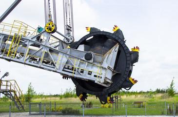 Opencast brown coal mine. Excavator SchRs-315. Extractive industry.