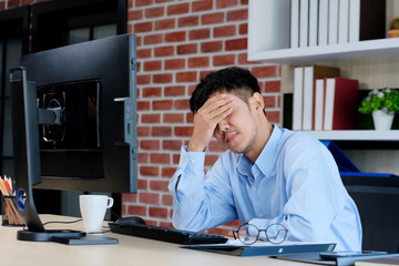 Young asian office man struggle with computer, Frustrated asian business man looking at computer while working at office, Business people struggle with technology