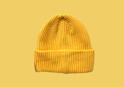 Yellow winter hipster hat pattern isolated on yellow background. Fashion casual winter hat. Winter Wooly Hat. Winter clothes pattern. Banner concept