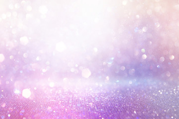 abstract glitter pink, purple and gold lights background. de-focused