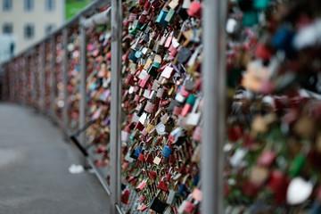 Closeup of love lockers at famous bridge Makartsteg in Salzburg, Austria. Padlocks of love on a bridge.
