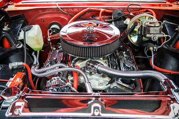 Under the hood of a hot rod muscle car.
