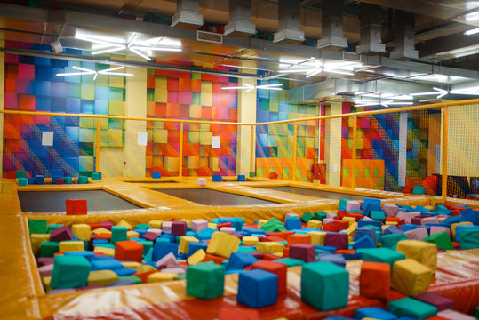 Kids trampoline and soft cubes on playground