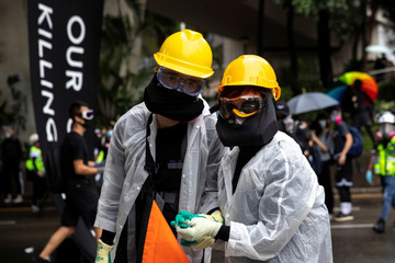 A couple of anti-government protesters hold hands during a demonstration in Wan Chai district in Hong Kong