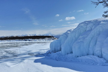 Winter on Lake Baikal. The huge blocks of stone were frozen as a result of the freezing of the washing waves.