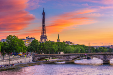 Wall Mural - Sunset view of Eiffel tower and Seine river in Paris, France. Eiffel Tower is one of the most iconic landmarks of Paris. Cityscape of Paris