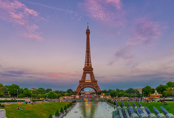 Wall Mural - View of Eiffel Tower from Jardins du Trocadero in Paris, France. Eiffel Tower is one of the most iconic landmarks of Paris. Sunset cityscape of Paris
