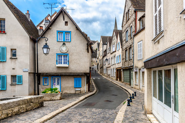 Wall Mural - Cozy street with old houses in a small town Chartres, France
