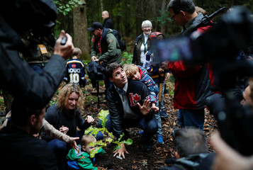 Liberal leader and Canadian Prime Minister Justin Trudeau attends a tree planting with his son Hadrien during an election campaign visit to Plainfield