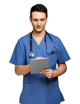 Male nurse using a digital tablet isolated on white