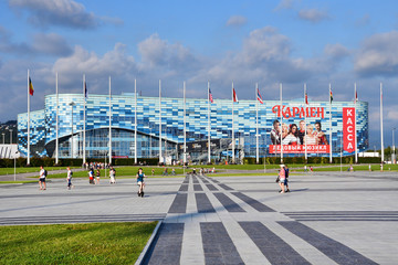 """Sochi, Russia, August, 10, 2019, People walking near Ice palace """"Iceberg"""" in Sochi Olympic Park in summer"""