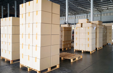 Stack cardboard boxes on wooden pallets, warehouse industry delivery logistics transport