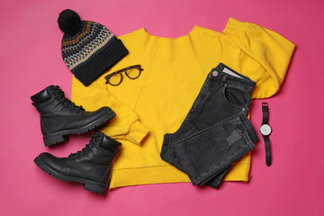 Fototapete - Flat lay composition with winter clothes and boots on pink background