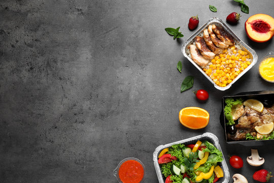 Lunchboxes on grey table, flat lay. Healthy food delivery