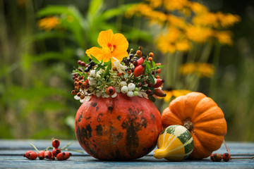 Hollow pumpkin with floral decoration