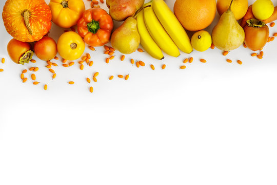 Fresh autumn yellow and orange vegetables and fruits isolated on white background, top view. flat lay. autumn background.