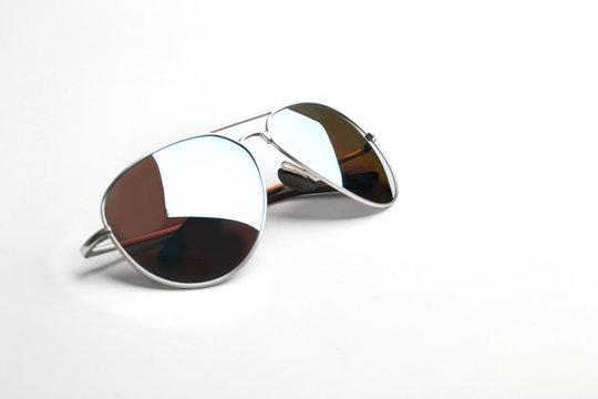 Stylish sunglasses on white background. Fashionable accessory