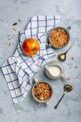 Granola in bowls and a jug of milk for breakfast.