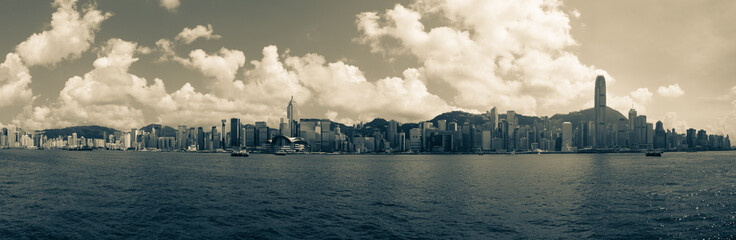Large Cityscape Panorama with Victoria Bay and Hongkong Island in the background taken from Kowloon. Hong Kong, China, Asia