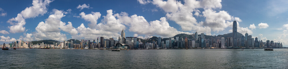 Large Skyline Panorama with Victoria Bay, Transportation Ships and Hongkong Island in the background taken from Kowloon. Hong Kong, China, Asia