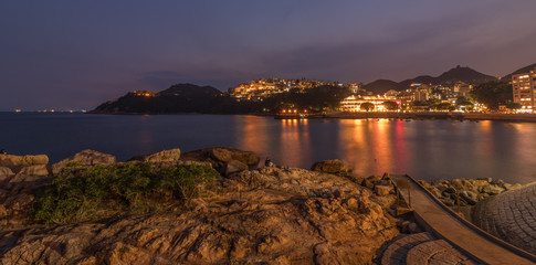 Romantic Panorama view on evening Skyline of Stanley Village, Bay and Harbour on Hongkong Island. Chek Chue, Hong Kong, China