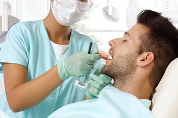 Young man at dental surgeon