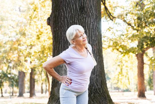 Senior woman exercising at park