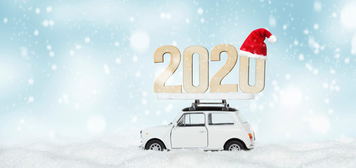 small car brings the new year 2020