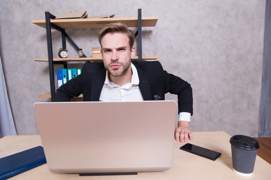 Man strict bearded boss top manager in office. Ceo concept. Leave office right now. Failed job interview. Firing employees. Serious boss picky looking at camera. Boss with laptop in bad mood