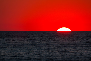 Tuinposter Rood Ionian sea , red sunset, Salento, Italy