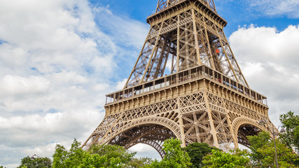 Aluminium Prints Eiffel Tower Eiffel Tower in Paris France on a beautiful Spring day with blue sky and white clouds