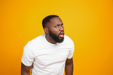Shocked African-American man on color background