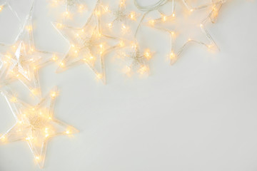 Beautiful glowing garland on white background Fototapete