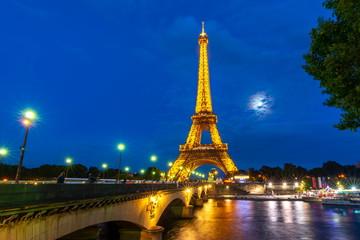 Eiffel tower and Seine river at night illumination, Paris, France