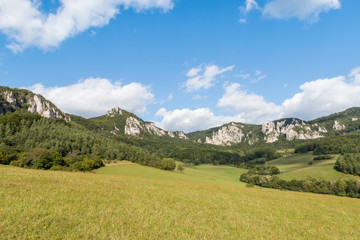landscape with meadow, mountain range and Sulov Rocks in Slovakia, Central Europe