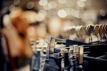 Jeans on the hanger in the store. Shopping in store.
