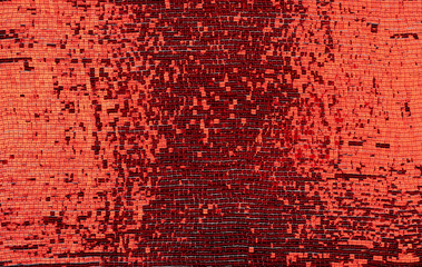 fragment of fabric embroidered with red square sequins,