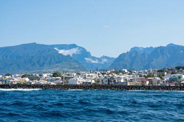 """Closeup of ocean view of St. Pierre, Réunion island with the """"Entre-Deux"""" at the center of the picture"""