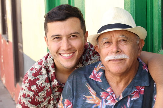 Hispanic senior man with his son