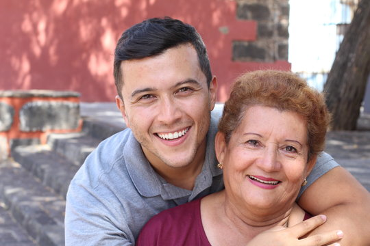 Hispanic senior woman with her son