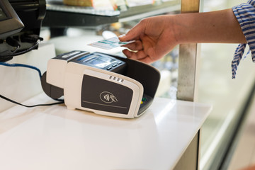 woman paying with credit card using paywave