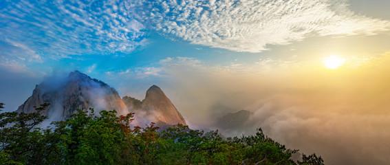 Fotobehang Seoel Panorama of Bukhansan National Park with Clouds and fog at Sunrise in Seoul South Korea