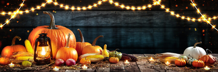 Wooden Table With Lantern And Candles Decorated With Pumpkins, Corncobs, Apples And Gourds - Thanksgiving / Harvest Concept