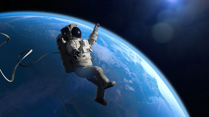 astronaut in orbit of planet Earth