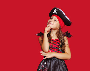 Foto op Canvas Carnaval Pretty pirate girl looking to the copy space area against red background