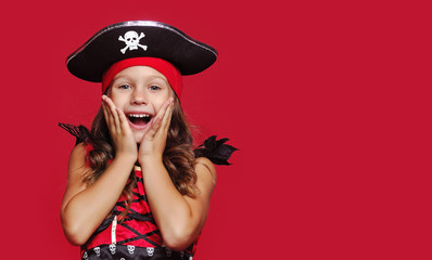 Close-up portrait of surprised girl dressed as pirate