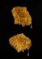Natural tasty organic honey beeswax closeup on black