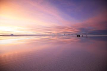 Scenic magic violet sunset in bolivian salar Uyuni