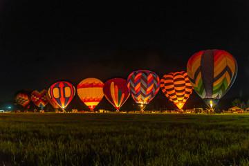 Poster Ballon Hot air balloons during a night glow at a balloon festival in Grants Pass Oregon
