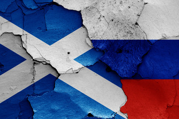 flags of Scotland and Russia painted on cracked wall